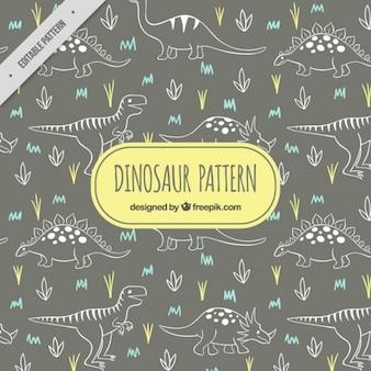 Patrón de dinosaurios esbozados