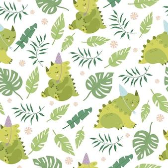 Patrón con dinosaurios y hojas de palmera.