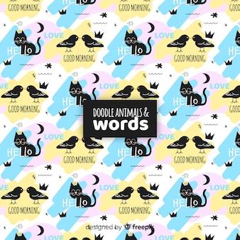 Patrón divertido garabatos animales y palabras