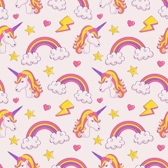 Patrón de ensueño con unicornios y arcoiris.