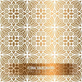 Patrón étnico floral dorado