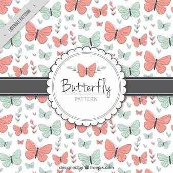 Patrón fantástico con mariposas rojas y azules
