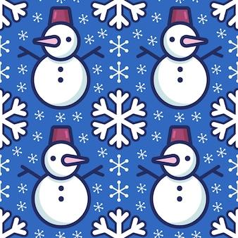 Patrón festivo brillante con lindos muñecos de nieve y copos de nieve sobre un fondo azul.
