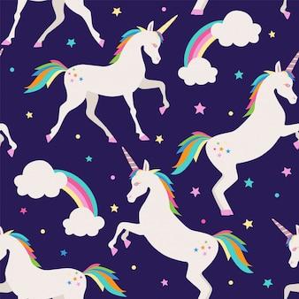 Patrón sin fisuras con el arco iris y unicornios.