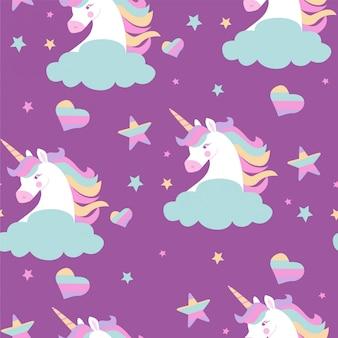 Patrón sin fisuras con cabezas de unicornios, estrellas, corazones y arco iris.