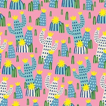 Patrón sin fisuras con cactus dibujado a mano sobre fondo rosa.