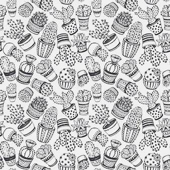 Patrón sin fisuras con cactus dibujados a mano en estilo boceto.