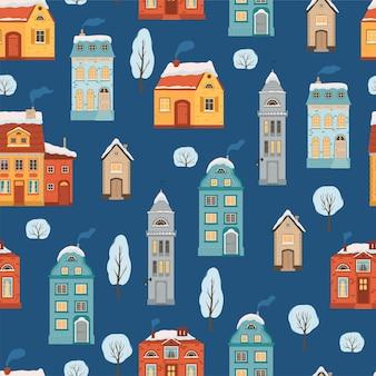 Patrón sin fisuras con casas de invierno de estilo plano. fondo de vacaciones de navidad con una acogedora ciudad de estilo retro. ilustración vectorial