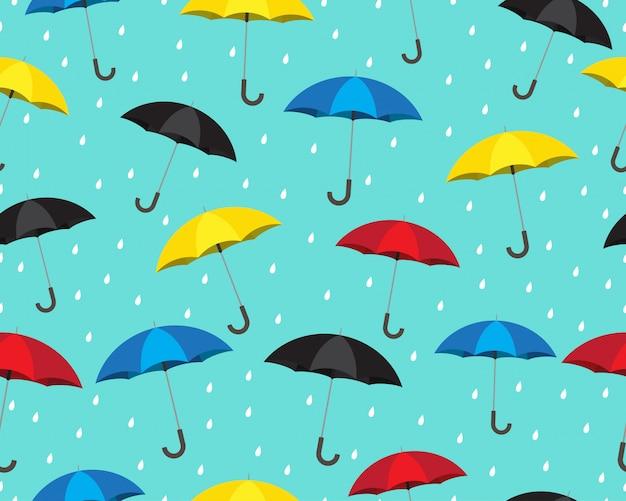 Patrón sin fisuras de coloridos paraguas con gotas de lluvia