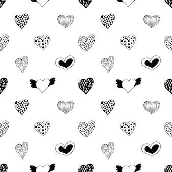 Patrón sin fisuras de corazones dibujados a mano.
