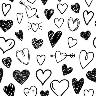 Patrón sin fisuras de corazones de dibujo negro