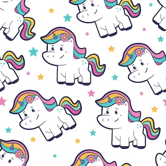 Patrón sin fisuras de dibujos animados lindo unicornio sobre un fondo blanco