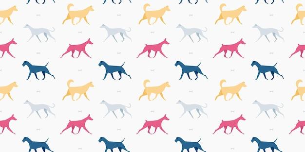 Patrón sin fisuras con diferentes razas de perros sobre un fondo claro