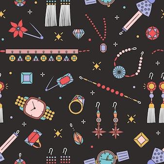 Patrón sin fisuras con elegantes artículos de joyería sobre fondo negro