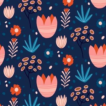 Patrón sin fisuras con flores y hojas sobre un fondo azul oscuro