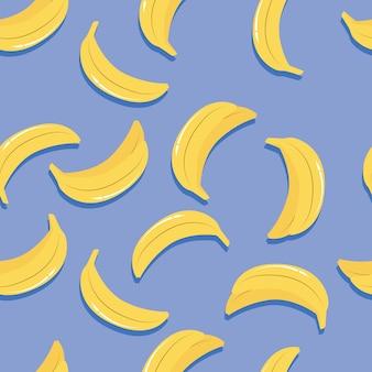 Patrón sin fisuras de fruta, plátanos con sombra sobre fondo azul brillante. fruta tropical exótica.