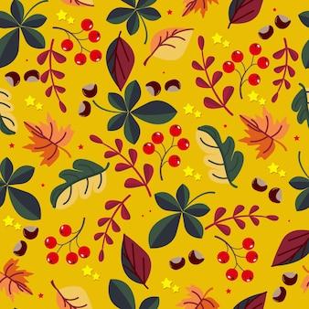 Patrón sin fisuras de frutos rojos con hojas verdes y amarillas sobre un fondo de color otoño brillante