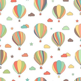 Patrón sin fisuras con globos de aire caliente, estrellas y nubes