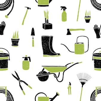 Patrón sin fisuras con herramientas de jardinería negras y verdes sobre blanco