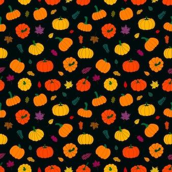 Patrón sin fisuras de hojas marchitas multicolores y calabazas maduras sobre un fondo oscuro