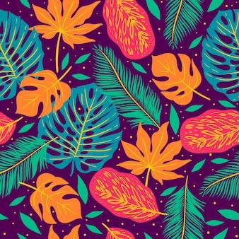Patrón sin fisuras con hojas tropicales sobre un fondo morado.