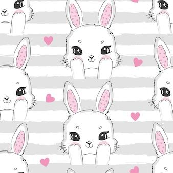 Patrón sin fisuras lindo conejo y corazón de color rosa. conejito dibujado a mano
