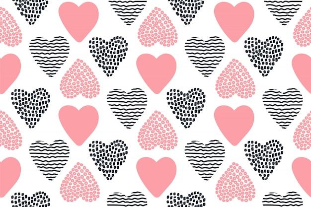 Patrón sin fisuras con mano dibujado corazones de san valentín.