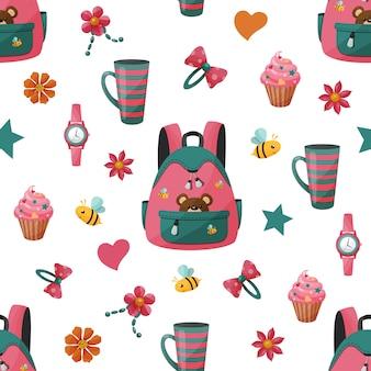 Patrón sin fisuras con mochila y cupcake de niña.
