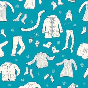 Patrón sin fisuras con motivo de ropa de invierno.