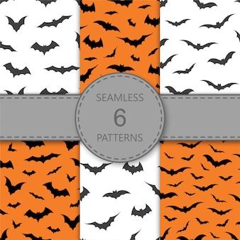 Patrón sin fisuras con murciélagos sobre fondo naranja y blanco, ilustración