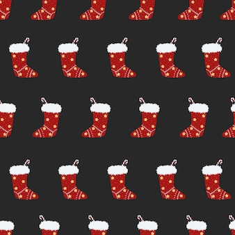 Patrón sin fisuras de navidad con calcetines de regalo sobre un fondo azul calcetín rojo neq año con caramelo