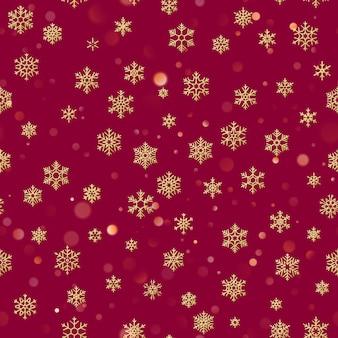 Patrón sin fisuras de navidad de copos de nieve blancas sobre fondo rojo.