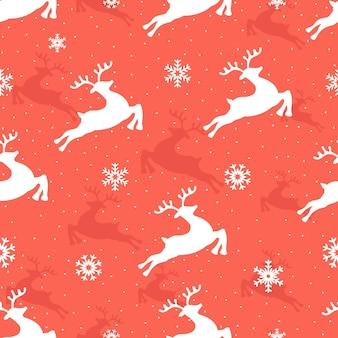 Patrón sin fisuras de navidad con renos y copos de nieve.