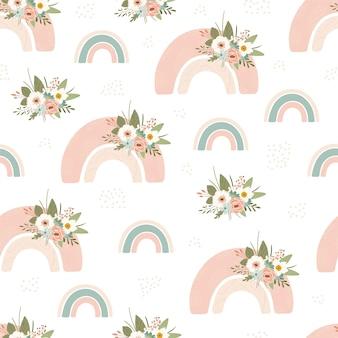 Patrón sin fisuras para niños con arco iris de primavera y flores en colores pastel.