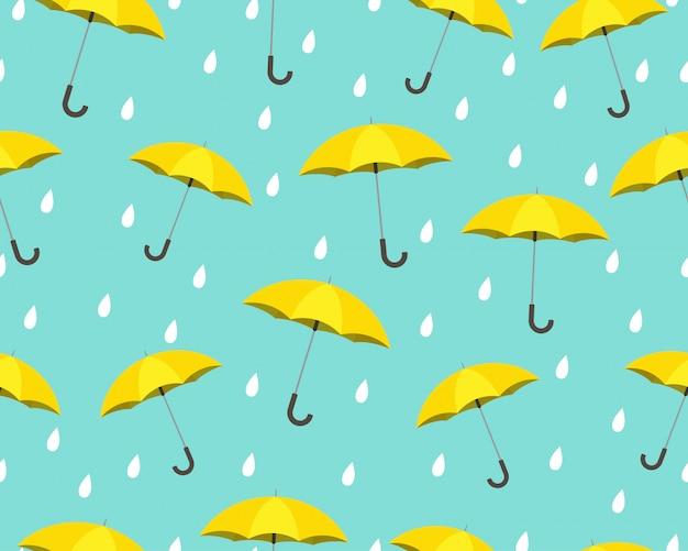 Patrón sin fisuras de paraguas amarillo con gotas lloviendo
