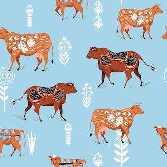 Patrón sin fisuras con siluetas de vacas y flores