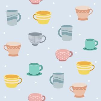 El patrón sin fisuras de la taza de té sobre fondo azul y lunares blancos.