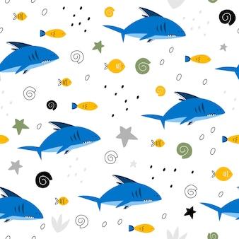 Patrón sin fisuras con tiburones y peces.