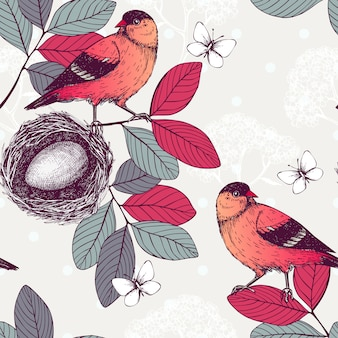 Patrón sin fisuras con tinta pájaros dibujados a mano en ramas de árboles. fondo de dibujo vintage con pájaros rojos.