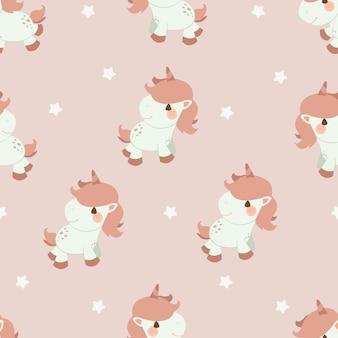 El patrón sin fisuras de unicornio y estrella en el fondo rosa.