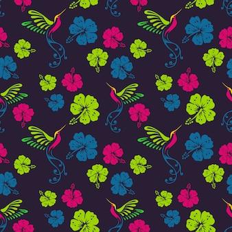 Patrón floral con colibrí y flores de hibisco.