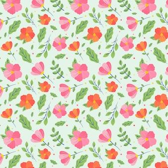 Patrón floral dibujado minimalista sobre fondo verde