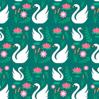 Patrón floral con elegantes cisnes blancos