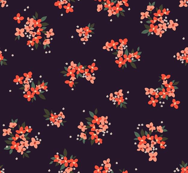 Patrón floral flores lindas fondo violeta oscuro diseño con pequeñas flores naranjas estampado ditsy