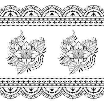 Patrón de flores y borde sin costuras. decoración en mehndi oriental étnico, estilo indio. ornamento de doodle en blanco y negro. dibujar a mano ilustración.