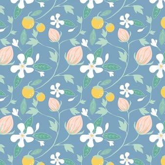 Patrón de flores, frutas y hojas sobre fondo azul