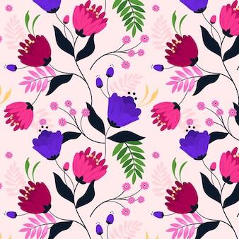 Patrón con flores y hojas tropicales