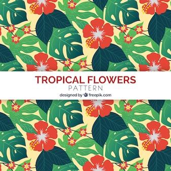 Patrón de flores tropicales con diseño plano