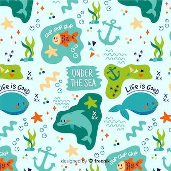 Patrón garabatos animales marinos y palabras coloridos