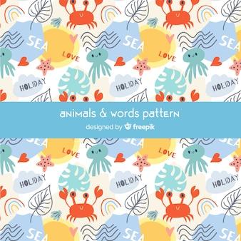 Patrón garabatos coloridos animales marinos y palabras